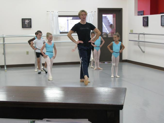 The Level 1A students in class with Ryan Carroll in their new aquamarine uniforms