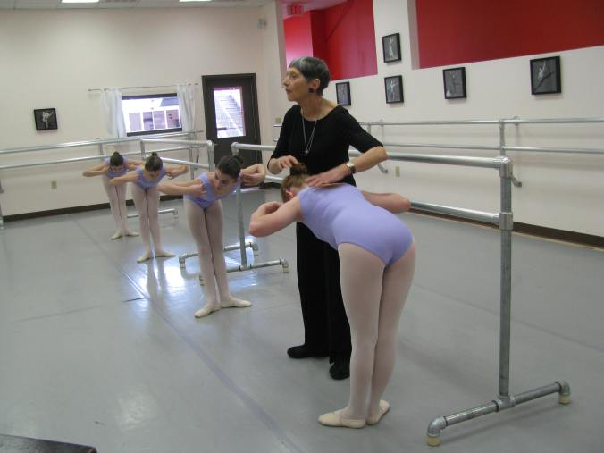 Nutmeg Conservatory's Joan Kunsch, friend and guest artist, works with a Level 2B student in class