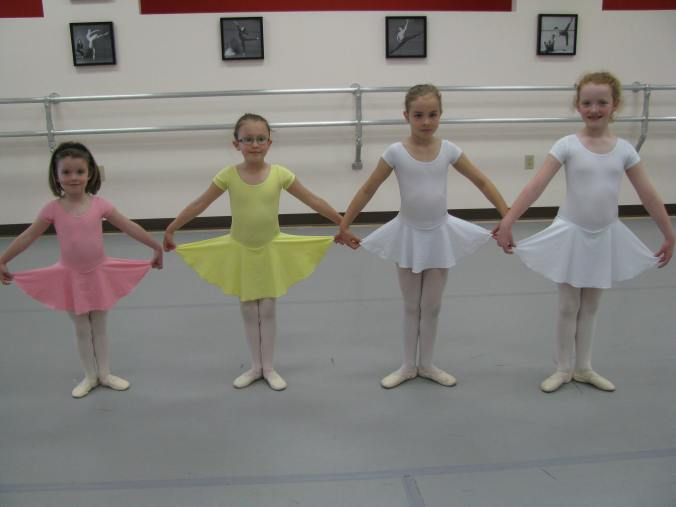 In fall of 2011 students returned to ballet school in American Ballet Theatre's new uniforms; here three levels of Primaries appear in one makeup class.