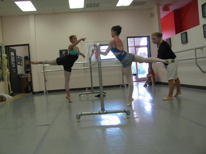 Mom, a master teacher and former ballerina, also worked some at the school when her busy schedule permitted.  Here she is seen working with one of her students who now dances professionally, and one of mine.