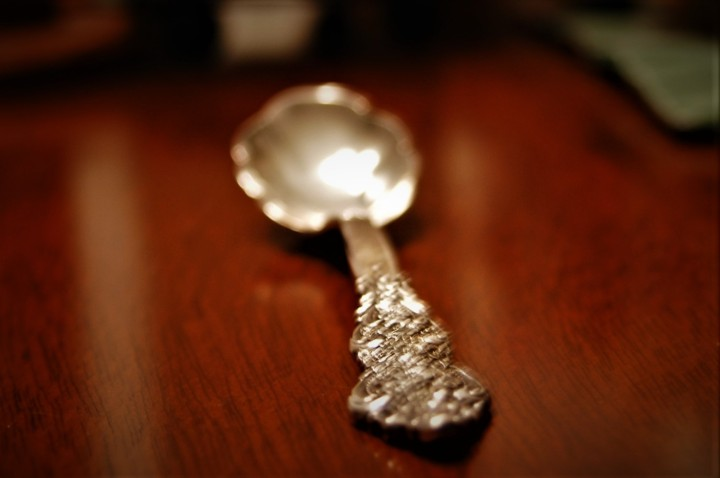 polished sterling silver spoon on table